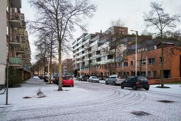 First snow in season, residential neighborhood Amsterdam, Netherlands. Selective focus