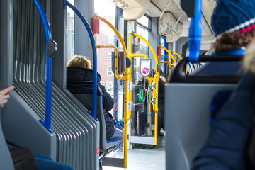 People inside the tram wagon. Selective focus