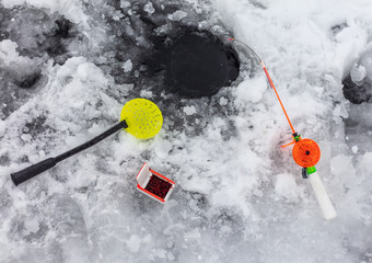 Small fishing pole for ice fishing in winter