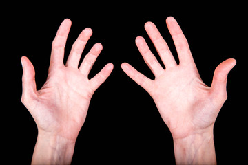expressive slender skinny female hands in various poses on a black background