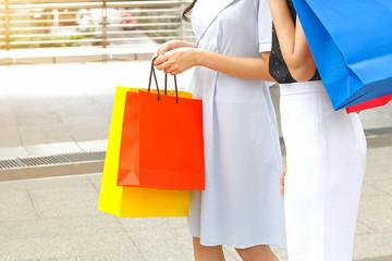 Women with shopping bags walking on sky walk