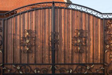 Metal wrought iron gates. Part of the vintage wrought iron gate. Background, texture of metal gates.
