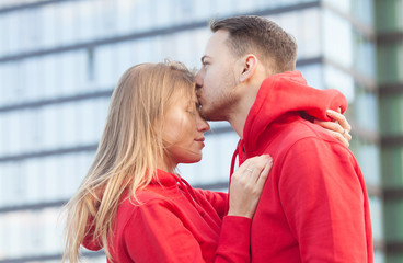 Young couple in love outdoor.Stunning sensual outdoor portrait of young stylish fashion couple.