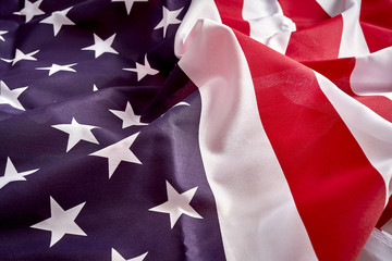 Close up on rippled and unsmooted flag of America.