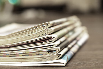 Newspaper Headlines and Articles in News Journals and Magazines. Stack of Newspapers, Business Concept