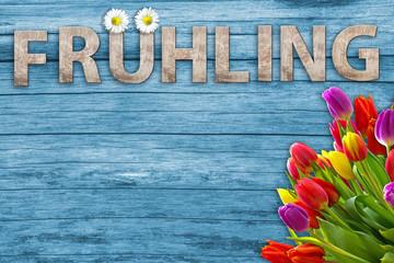 Wall Mural - Bald kommt der Frühling - Holz Schrift mit bunten Blumen