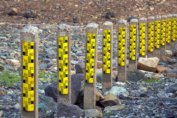 Stone columns measure water level in the dam.