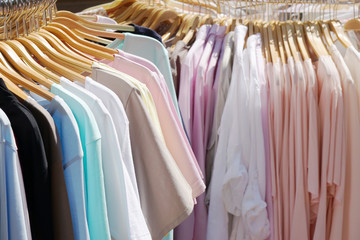 clothes rack with pastel-colored women's spring and summer fashion