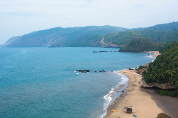 A cliff top view of Cola Beach in Goa, India on a bright sunny day