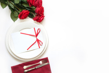 Valentine's day dinner. Romantic table setting with red roses. View from above.