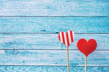 Valentines day concept. Red hearts on blue boards background. Copy space.
