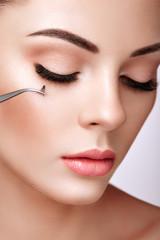 Wall Mural - Beautiful Woman with Extreme Long False Eyelashes. Eyelash Extensions. Makeup, Cosmetics. Beauty, Skincare. Woman Glues Eyelashes