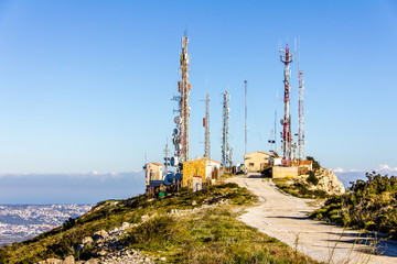 """Telecommunication antennas in the Cumbre del Sol mountain, also known as """"Puig Llorenca"""" in Benitatxell, Spain."""