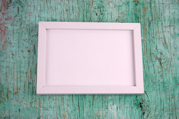 white wooden blank frame on a vintage shabby background
