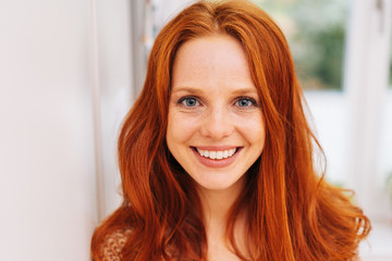 Young red-haired woman close-up portrait