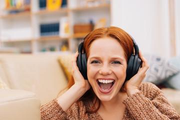 Woman listening to music in headphones