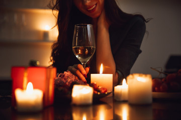 Close up of a woman sitting with glass of wine