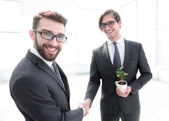 handshake of young business partners