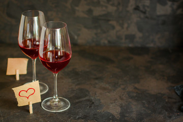 red wine, transparent glass (beverage and a note with a heart). top