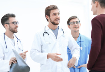 group of doctors discussing a patient's x-ray