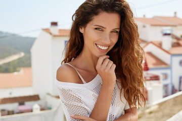 Portrait of a beautiful joyful young woman. Smiling girl.