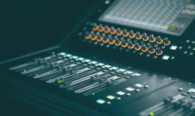 Light and Sound control mixer for Event on stage. Professional backstage device equipment. Professional sound and audio mixer control panel with buttons and sliders.