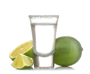 silver tequila in a glass glass with lime close up on a white isolated background