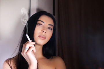 A beautiful woman is smoking