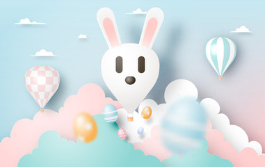 Happy easter day in paper art style with bunny hot air balllon and eggs
