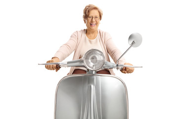 Cheerful senior woman riding a vintage scooter