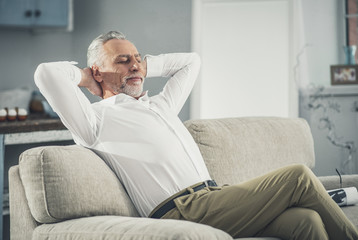 White collar worker feeling relaxed after coming back home