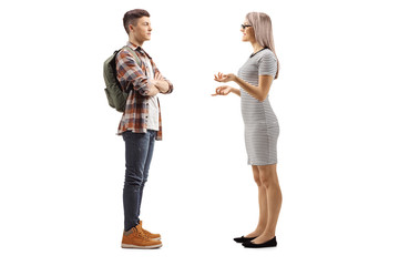 Teenage male student talking to a young woman