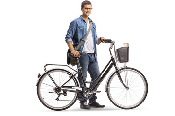 Casual young man standing with a bicycle
