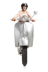 Mature woman with a hlemet riding a vintage scooter