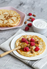 Homemade Pancakes with Raspberry, Almond Nuts and Honey Easy Food Concept Breakfast