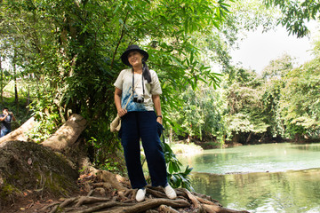 Traveler thai woman travel and posing for take photo at Chet Sao Noi small waterfalls at Muak Lek District in the Saraburi Province of Thailand.