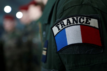 A France military patch is seen on the uniform of a paratrooper ahead of a military ceremony to be attended by the French President at the Toulouse-Francazal military airbase in Toulouse