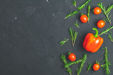 Rosemary bunch, raw pepper and cherry tomatoes