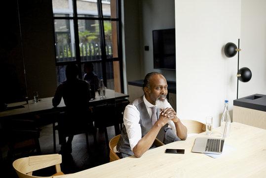 Businessmen sitting in office