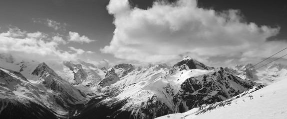 Fototapete - Black and white panorama of ski slope and cloudy mountains