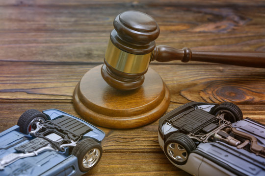 hammer judges, inverted cars on wooden background. court. claim.damnification.