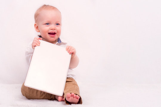 Cute baby boy holding a banner against white background. Copy space