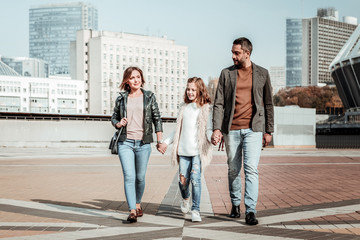 Family members walking together in the city center