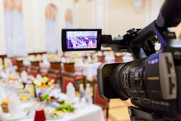 Video shooting at a restaurant at a Banquet. Camcorder with LCD display.