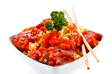 Rice with sauce and meat on white background