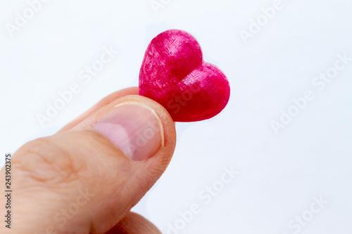 Little Heart Finger Holding A Heart Bonbon Stockfotos Und