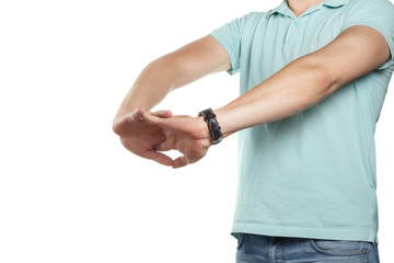 Young man stretching his hands, isolated on white background