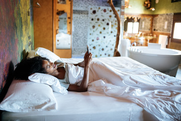 Woman in the bed with mobile phone