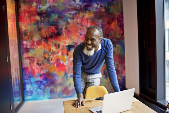 Senior black creative professional presenting in a meeting