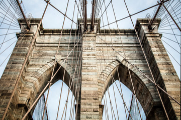 Brooklyn Bridge pylon structure made out of bricks during summer sunny day
